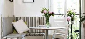 Bancos na sala de jantar dão mais espaço no ambiente