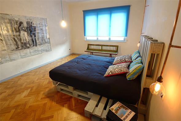 Como fazer uma cama de paletes 016